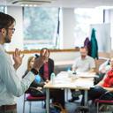 Man teaching a small class. Photo by Ian Wallman.
