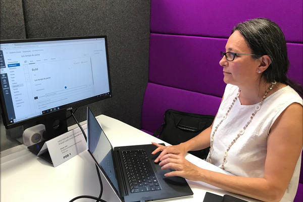 Marion Sadoux working in Canvas on a laptop and larger screen.