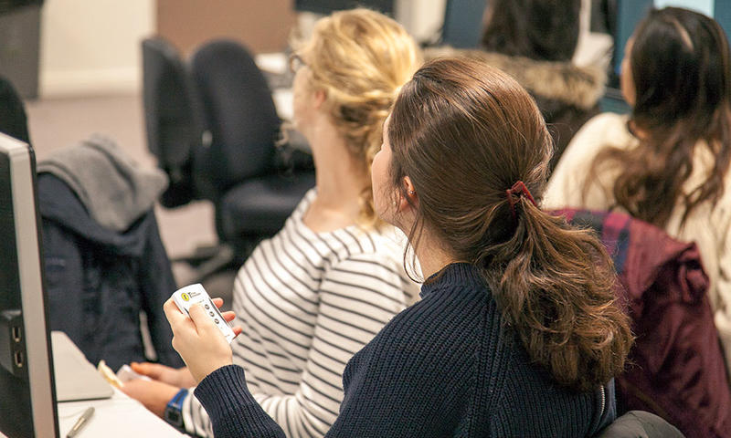Students with polling handsets during a class. Photo by Xavier L.